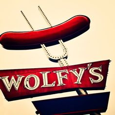 Photograph of a neon sign (Wolfy's Hot Dog) in Chicago by Tracey Capone