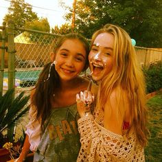 Rowen Blanchard and Sabrina Carpenter hanging out with cake on their faces at least I hope so.