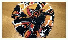 Oklahoma State University fabric flower for hair or as a pin I made. letsgobabygear.com