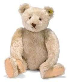A STEIFF WHITE TEDDY BEAR, (5343,2), jointed, mohair, brown and black glass eyes, brown stitching, inoperative growler, blued FF button with full yellow cloth tag and US-Zone tag in arm seam, 1949 --16in. (40.5cm.) high (right paw pad with slight repair)