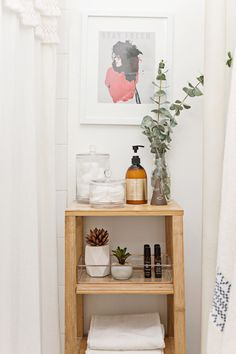 A tiny bathroom can serve up big problems. When you're hard-pressed to find room for your most basic essentials (like, spare towels, cotton balls, and extra toilet paper), a rockstar shelving unit can solve all your small bathroom decorating woes. In this breezy and bright Brooklyn bathroom, a touch of eucalyptus, a copper-lined tray, and a charming print elevate the simple wood shelving system.