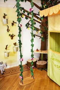 An enchanted forest themed kids' playroom by Jen Talbot Design My mom thought I was crazy when she saw that I put a swing in my new master!  Lol