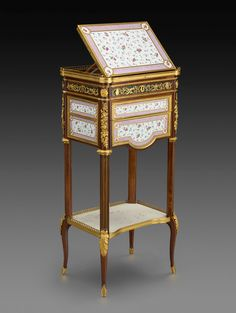 Martin Carlin  (ca. 1730 - 1785)  French, Eighteenth Century Mechanical Table, ca. 1780 Oak veneered with maple; plaques of soft-paste porcelain; gilt bronze 45 3/4 x 14 1/8 x 10 3/4 in. (116.2 x 35.9 x 27.3 cm)