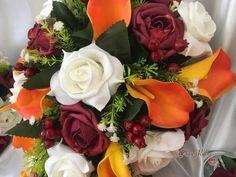 This package reflects the colours of any autumnal day. They consist of burnt orange calla lilies, burgundy roses, groups of very realistic looking berries and i