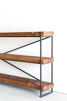 Materials: Reclaimed Fir, Industrial Steel Process: This Bookcase is Custom Made in Los Angeles. Industrial Metal Frame welded and salvaged wood beams