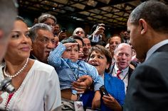 A young boy salutes President Barack Obama as he greets audience members following his remarks at the NALEO Conference in Orlando, Fla., June 22, 2012. (Official White House Photo by Pete Souza)