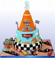 Pixar cars themed cake for my sons 3rd birthday, mad on lightening mcqueen! 3 tiers of cake!