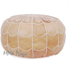 Arch Design Moroccan Pouf - known for bringing elegance and comfort to any space. Our selection is hand picked by our staff, all handmade by Artisans in Morocco. Timeless tanneries continue to produce wonderful high quality leather. The poufs are handmade with 100% genuine leather from Morocco then hand-stitched with silk embroidery.  MPW Plaza, focused on bringing you quality products, only.  Dimensions: 14 inches high x 20 inches in diameter.  For recommendations on how to stuff the pouf…