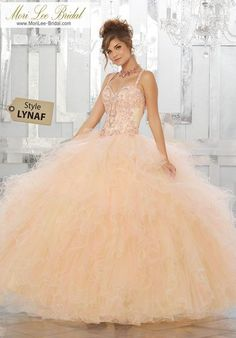 Beaded and Embroidered Bodice on a Ruffled Tulle Ball Gown Fit for a Princess, This Tulle Quinceañera Ballgown Features a Beautifully Embroidered Sweetheart Bodice. A Full Ruffled Tulle Skirt Complete the Look. Matching Bolero Jacket Included.  89156