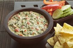 Espinaca Dip - really smooth queso dip with velveeta, cream cheese, whipping cream, Ro-Tel tomatoes with diced chilies and jalapeno peppers which provide a nice kick. a pinner says, Be warned! This recipe is very fattening and highly addictive! But it is a wonderful appetizer for parties and entertaining.