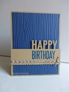 handmade birthday card from what did I do today?: Seize the Birthday + Simon Says Emboss ...masculine card ... luv the die cut HAPPY on the edge with stamped BIRTHDAY on the band ... masculine look in blue and kraft ... wood grain embossing folder texture on blue base layer ... pinked edge evokes saw edge ... great masculine birthday card!!