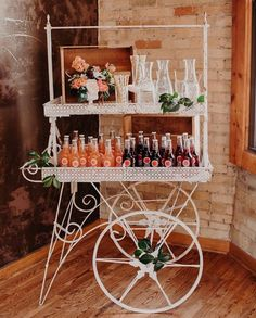 A refreshment from the Tiffany cart anybody. It's a beverage bar on wheels who could say no! Bring on class to any wedding, social event, reception, or home decor. | Relics Vintage Rentals
