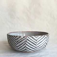 "A hand carved unique stoneware bowl with a dark brown and matte white exterior. The inside of the bowl is very light grey shino that will get more beautiful with use. Height 3"" Diameter 7.5"" Hand-wash Recommended."