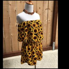 Sunflower Shorts Romper/Jumper Navy blue background and yellow & brown sunflowers. This 100% Polyester shorts romper/jumper has a 100% Polyester black lining under the top. Excellent condition. NO spots or damage. Price drop was $20. Persaya Shorts