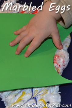 Use the shaving cream marbling technique to make marbled eggs with your child to decorate for Easter!