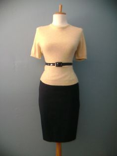 Wear a sweater over the pencil skirt and belt the sweater