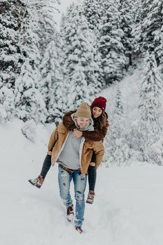 Snowy winter engagements piggy back ride Utah mountains couple session photoshoo. - Snowy winter engagements piggy back ride Utah mountains couple session photoshoot pine trees beanie - Winter Couple Pictures, Winter Engagement Pictures, Winter Pictures, Winter Family Photos, Snow Photography, Couple Photography Poses, Christmas Photography Couples, Levitation Photography, Exposure Photography