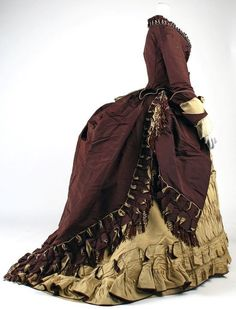 Beautiful big 1870's bustle dress calls for an elliptical cage crinoline with a mini bustle cage resting over the elliptical cage. This is  super mega drama.