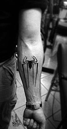 Arm tattoo: Spider-Man icon
