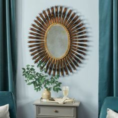 Spectacular texture and reflected light for that special focal point over a fireplace, above a console or powder room vanity. Our Aysha Mirror is meticulously crafted in a double ring of curled iron with a twisted iron edge defining the graceful oval glass shape.