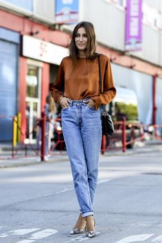Blue denim is inherently casual, so to make it feel a little more dressy and grown-up, tuck in a silky, long-sleeve blouse and then add tonal pumps.