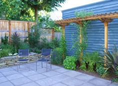 Pergola in side yard garden - could grow grapes or hops!