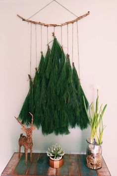 This was a favorite Christmas Tree wall hanging I made from left over pine garland. DIY from pine garland, coir roping and a stick. Such a unique Christmas Tree DIY Decoration! I can't wait to make one again! Bohemian Christmas, Natural Christmas, Simple Christmas, Winter Christmas, Christmas Home, Christmas Crafts, Wall Hanging Christmas Tree, Pine Christmas Tree, Chrismas Tree Diy