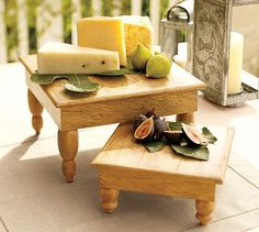 wood cheese boards...maybe take an old drawer, turn it upside down, add pegs??