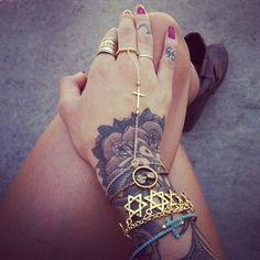 rose tattoo on hand and arm. rose sleeve tattoo.