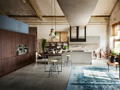 Kitchen with peninsula TOURS by Callesella Arredamenti