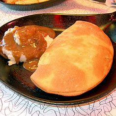 North Dakota: Fleischkuechle  You can thank German immigrants for this local favorite, called Fleischkuechle, which is a meat patty smothered in a fried dough wrapping.