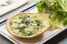 Zucchini & Parmesan Quiches  with Green Leaf Lettuce Salad & Pink Lemon Vinaigrette . Visit https://www.blueapron.com/ to receive the ingredients.
