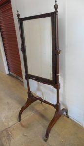 Rare cheval mirror found in the garden district of New Orleans in the mid-20th century. It combines the legs of a campeche chair with the tall slender posts of a few early Louisiana beds. To be sold at Neal Auction, New Orleans, LA—Nov 17–19, 2017.