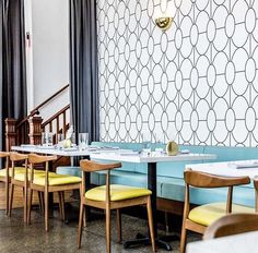 Pretty turquoise banquette, graphic wallpaper, yellow mid century modern dining chairs. Retro vibe // Dining room Inspiration - : Brittini Mehlhoff IG