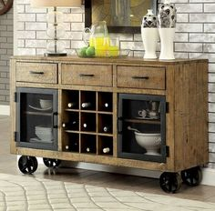 Industrial style server on 4 metal caster with storage drawers and wine rack.