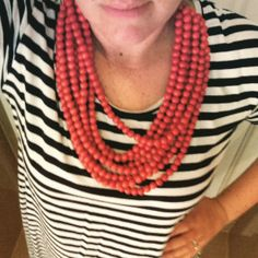 Super Bowl chic. What I wore: Orange (in support of the Denver Broncos) wood and leather Elk Necklace. Striped dress from Birdsnest.