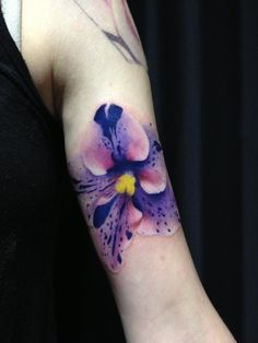 Realistic African violet tattoo done by Johnny Tattoo in Vilseck, Germany
