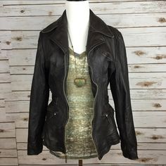 """[Nine West] Leather Biker Moto Jacket Chic Edgy Awesome fitted leather jacket. Wide lapel. Zip front. 2 zip front pockets. Buckles on each side at the waist to make more fitted. Lined.  Color: Very dark brown almost looks black Bust: 16"""" Length: 23"""" Condition: GUC. Some wear on collar and top of shoulders. Shown in last photo. Overall in good condition.   No Trades! Nine West Jackets & Coats"""