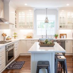 When I designed this kitchen I envisioned a brighter and more open space. Even though we had a budget I was able to mix higher end and more modest materials to stay on track - areas where we splurged: cabinet hardware, Quartz countertops, appliances, sink & faucet, & lighting - areas where we saved - range hood (open box item at appliance store so was discounted, backsplash, stools, & @ikeausa cabinets - you don't have to spend a fortune to make your kitchen look and feel more updated and…