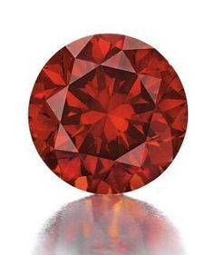An exceedingly rare fancy reddish-orange diamond of 3.15 carats, the largest reddish orange diamond ever graded at the GIA. Exhibiting two of the rarest hues in the world of diamonds, this rarity sold for 2.1M, setting a new auction record for a reddish-orange diamond and a new per-carat record price of  666,200.