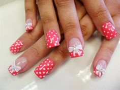 Pink nails with dots and bows