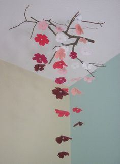 pretty mobile (like the stick idea for the crib mobile-not flowers though)