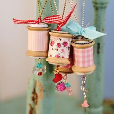 These vintage spools, ribbon, and a little bling make great light/ceiling fan pulls.