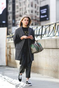 If you're going to wear somewhat-sleeveless outerwear, balance things out by sporting longer sleeves underneath.  #refinery29 http://www.refinery29.com/2016/02/103173/ny-fashion-week-fall-winter-2016-street-style-pictures#slide-5