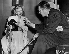 Ginger with her dachshund Lady on the set of Weekend at the Waldorf
