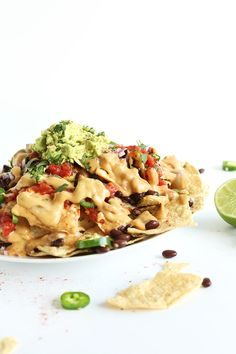 The best damn vegan nachos with cashew-less vegan queso, 3 ingredient guacamole, black beans, salsa and fresh cilantro. SO delicious and surprisingly healthy!