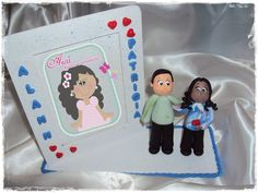Porta retrato com biscuit de casal R$50,00