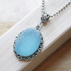 Eco friendly Recycled sea glass bezle style on a stainless steel necklace