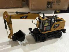 Diecast Masters - Booth Bauma 2016: Caterpillar M318F Wheeled Excavator