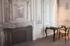 Martin Margiela redecorated hotel La Maison Champs Élysées in Paris.  The black and white wall paper creates the illusion of an open fire
